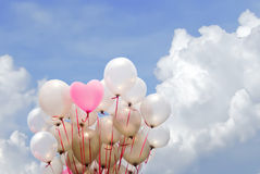 Heart pink  balloon on cloudy sky. Heart pink balloon on cloudy sky for valentine day Stock Photos