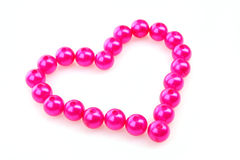 Heart from pink beads Royalty Free Stock Images