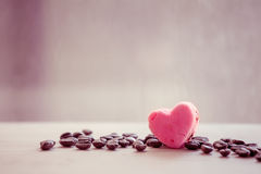 Heart pink cookies with coffee bean on rainy day window Royalty Free Stock Photography