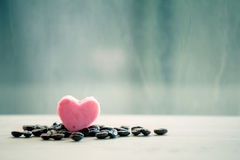 Heart pink cookies with coffee bean on rainy day window Royalty Free Stock Images