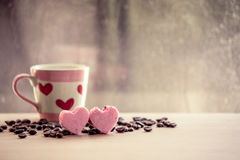Heart pink cookies and coffee cup on rainy day window background Royalty Free Stock Photo