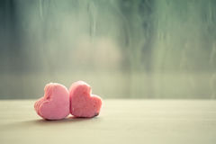 Heart pink cookies on rainy day window background Royalty Free Stock Photo