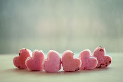 Heart pink cookies on rainy day window background Stock Image