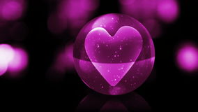 Heart in pink glass ball stock video footage