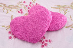 Heart pink pillows on bed sheet Stock Photo