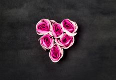 Heart of pink roses on black backgraund royalty free stock image