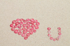 Heart from pink  snails Stock Photos