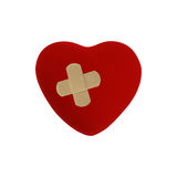 Heart with plaster Stock Photos