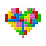 Heart from plastic toy blocks. Royalty Free Stock Photos