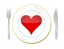 Heart on the plate with fork and knife Stock Images
