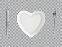 Heart plate, fork and knife, empty table setting