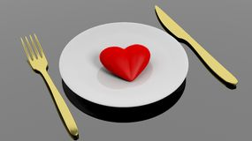 Heart on plate with golden fork and knife Royalty Free Stock Photos