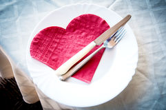 Heart plate. Heart shaped napkin on plate Royalty Free Stock Photo