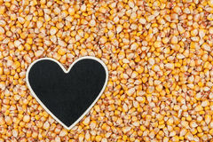 Heart pointer, the price tag lies on grains corn Stock Photos