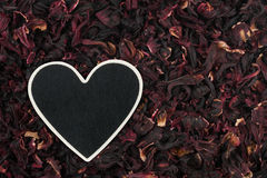 Heart pointer, the price tag lies on hibiscus Royalty Free Stock Photo