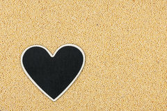 Heart pointer, the price tag lies on millet Royalty Free Stock Image