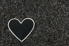 Heart pointer, the price tag lies on sunflower seeds Royalty Free Stock Photo