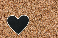 Heart pointer, the price tag lies on wheat Stock Photo