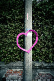 Heart on a pole. Pink heart cutout made of carton attached to a concrete pole Stock Photos