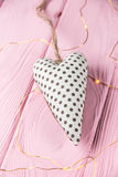 Heart with polka dots on a wooden background Stock Photos