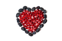 Heart from pomegranate and raisins. Love Royalty Free Stock Photo