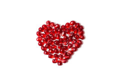 Heart of pomegranate seeds on a white background. Valentine's day Stock Images