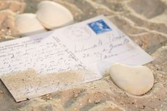 Heart with postcard in the sand Stock Photo