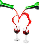 Heart from pouring red wine Royalty Free Stock Photo
