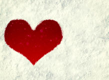 Heart print in the snow Stock Images