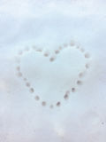 Heart print on the snow. Heart on the snow for valentines day Stock Photo