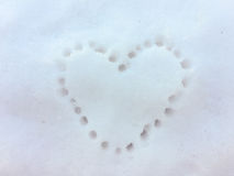 Heart print on the snow. Heart in the snow, heart print on the snow at winter Stock Image