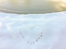 Heart print on the snow. Heart in the snow, heart print on the snow at winter near the lake Royalty Free Stock Images