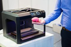 The heart printed on a 3d printer. The engineer demonstrates the heart printed on a 3d printer royalty free stock image