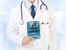 Heart problems. Doctor showing diagnosis of cardiovascular disease royalty free stock photography