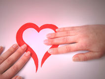 Heart protection. Shining handpainted hearth& hands covering it Royalty Free Stock Photo