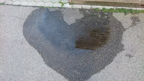Heart puddle Royalty Free Stock Photography