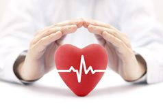 Heart pulse covered by hands royalty free stock photography