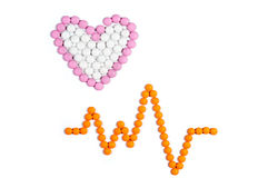Heart and pulse. Isolated hearts and pulse made from tablets on white background stock images