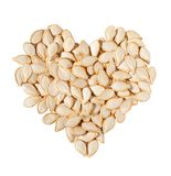 Heart from pumpkin seeds isolated on white Royalty Free Stock Photos