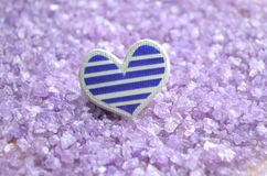 Heart on purple  background Stock Photo