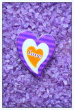 Heart on purple  background Royalty Free Stock Photos