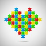 Heart from puzzle pieces Stock Photography
