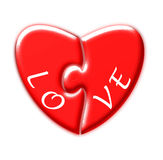 Heart puzzle and the word love Royalty Free Stock Photos