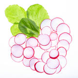 Heart Of Radish. Slices of radish in a heart shape, illuminated from the back, over white background Royalty Free Stock Photos