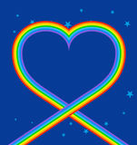 Heart of rainbow in sky. LGBT symbol of love. Blue skies and sta Stock Photo