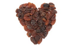 Heart of raisins isolated on white background Stock Images