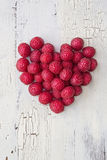 Heart from rasberries Stock Photography