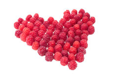 Heart of raspberries isolated on white. Heart of ripe freash raspberries isolated on white Royalty Free Stock Image
