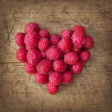 Heart from raspberries Stock Photos