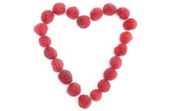 Heart of raspberries on white background Royalty Free Stock Images